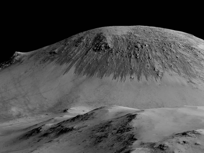 <p>Imagem mostra o que os cientistas conhecem pela sigla RSL (Recurring Slope Linear, em português algo como Linhas Recorrentes de Encosta), sulcos escuros que surgem nas bordas de crateras, cânions ou montanhas</p>