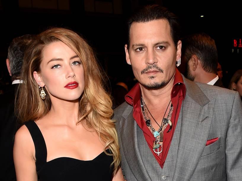 Johnny Depp e Amber Header comparecem ao Festival Internacional de Filmes de Toronto, no Canadá