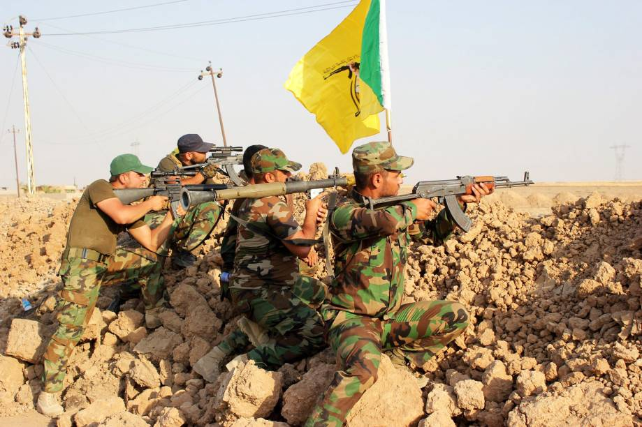 Voluntários Xiitas da milícia Hezbollah em combate contra o grupo extremista do Estado Islâmico na cidade de Amerli, Iraque - 01/09/2014