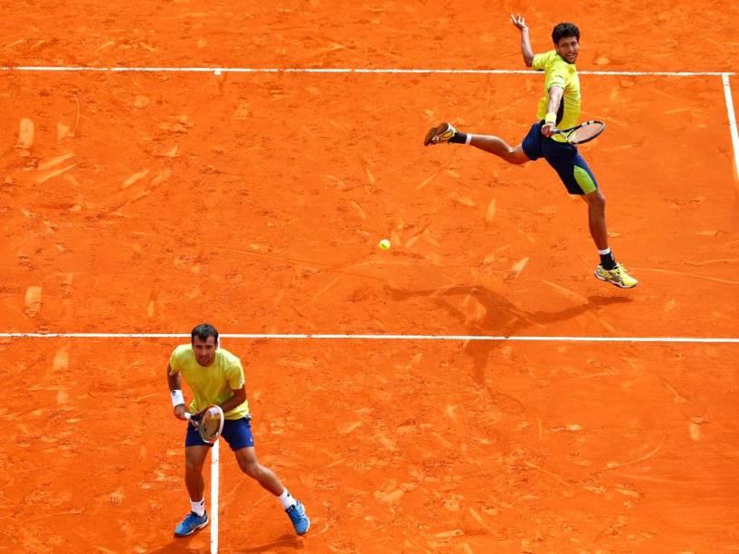 Marcelo Melo (à dir.) e Ivan Dodig venceram os dois duelos contra Bruno Soares e Alexander Peya em 2015