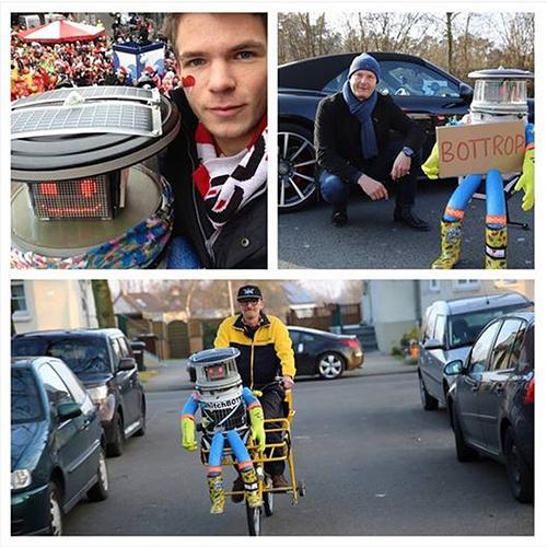 Em fevereiro deste ano, o robô HitchBOT foi passear na Alemanha e assistiu à parada do Rose Monday, um carnaval comemorado com flores e doces. Para chegar, pegou carona na bicicleta do carteiro.