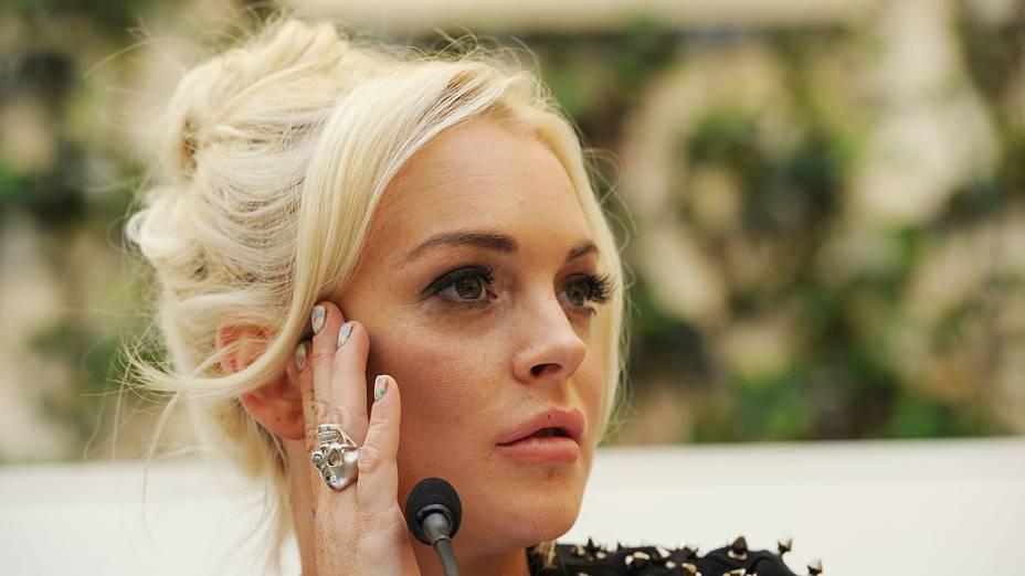 Lindsay Lohan é apresentada como o novo rosto da grife Plein durante Semana de Moda de Milão, Itália, em 2011
