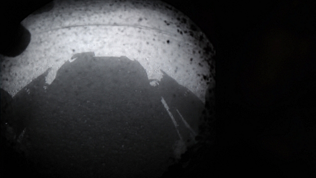 <p>Imagem divulgada pela Nasa mostra momento do pouso do jipe robô Curiosity em Marte</p>