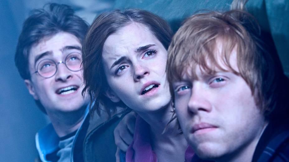 Harry, Hermione e Ron durante cena do filme <em>Harry Potter e as Relíquias da Morte: Parte 2</em>