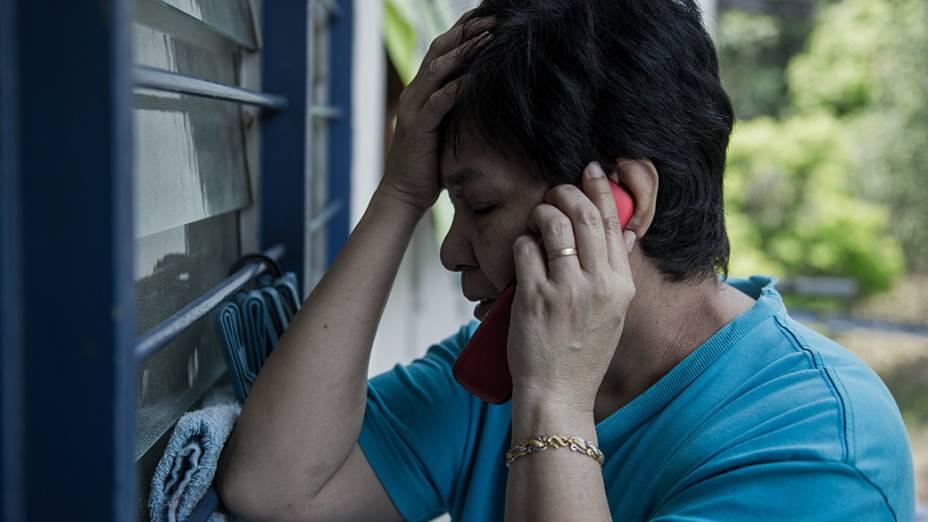 <p>Familiares buscam informações após desaparecimento do avião Malaysia Airlines que fazia o voo de Kuala Lumpur a Pequim transportando 239 pessoas</p>