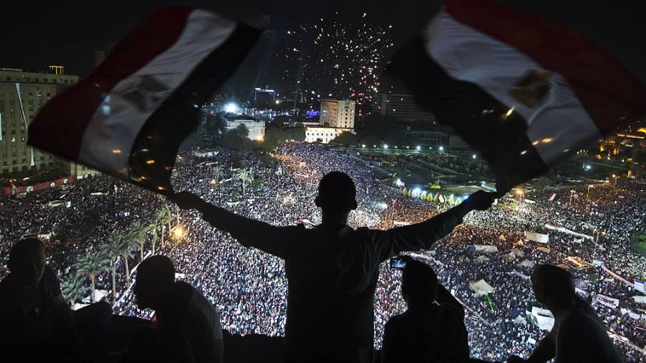 Manifestantes durante comício na praça Tahrir, no Cairo, em 26/07/2013