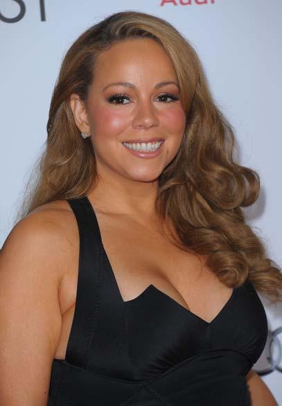 O modelo preto não foi o suficiente para disfarçar os quilos a mais de Mariah Carey na estreia do filme <em>Preciosa</em>, em 2009
