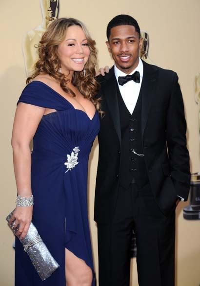 No Oscar 2010, Mariah Carey não conseguiu esconder a forma voluptuosa ao lado do marido Nick Cannon