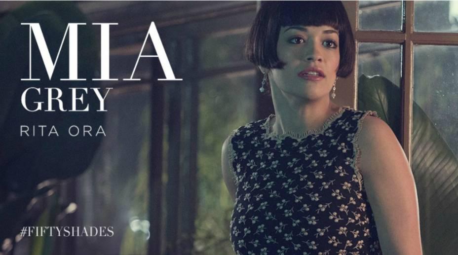 Mia Grey, irmã adotiva de Christian Grey, interpretada pela cantora pop Rita Ora, no filme Cinquenta Tons de Cinza
