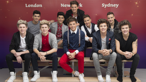 One Direction posa ao lado das estátuas de cera do grupo
