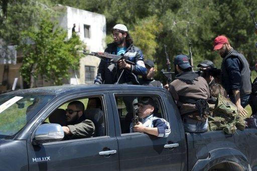 Membros da brigada al-Ezz bin Abdul Salamna província de Latakia, oeste da Síria, em 25 de abril de  2013