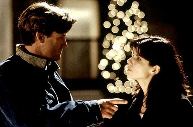Com Bill Pullman em <em>Enquanto Você Dormia</em> (1995).