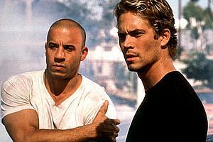 Ator Paul Walker ao lado de Vin Diesel, companheiro na franquia Velozes e Furiosos