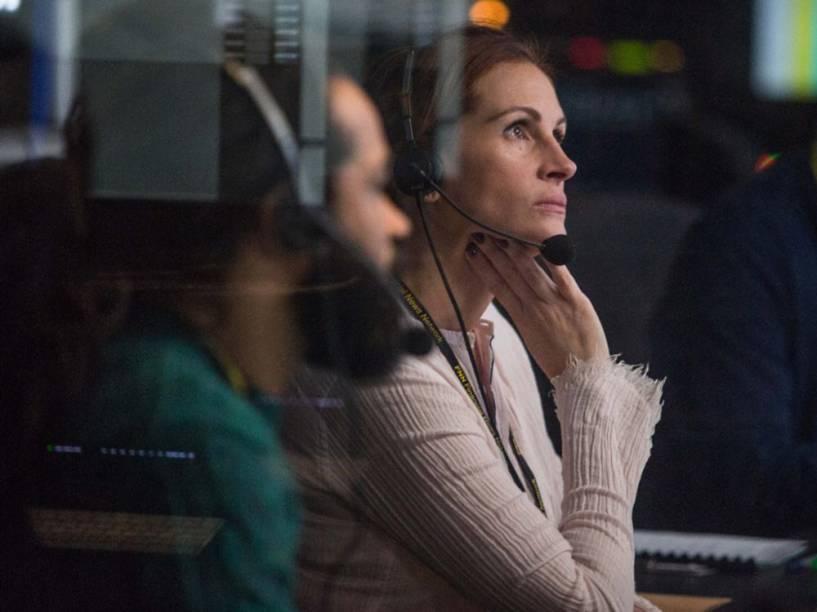 Patty (Julia Roberts), a diretora do programa Jogo do Dinheiro, apresentado por Lee Gates (George Clooney)