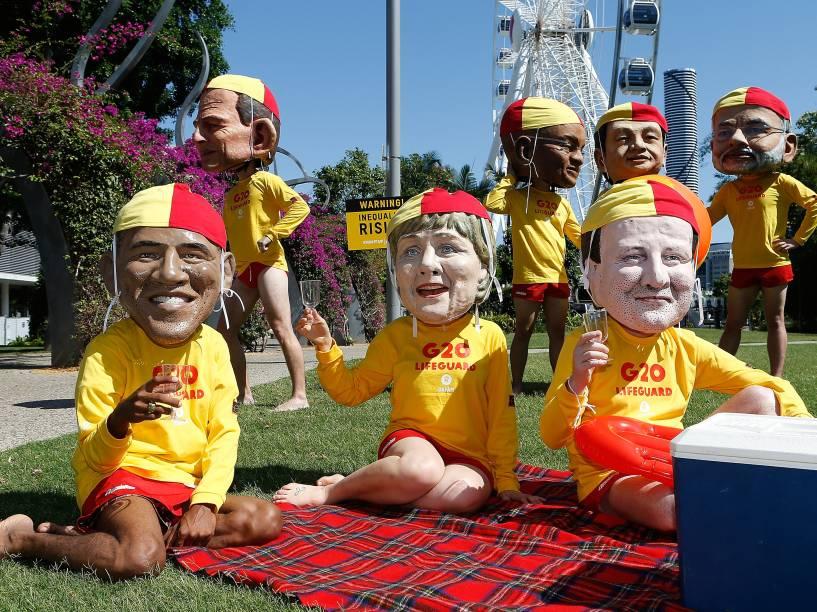 Ativistas posam com as cabeças de alguns dos líderes do G20 durante protesto contra a desigualdade em Brisbane, na Austrália. A cidade receberá nos próximos dias, a reunião dos principais líderes mundiais - 14/11/2014