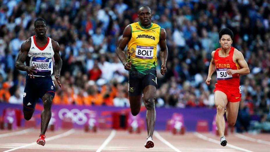 O britânico Dwain Chambers, o jamaicano Usain Bolt e o chinês Su Bingtian durante prova semi-final dos 100m nas Olimpíadas de Londres, em 05/08/2012