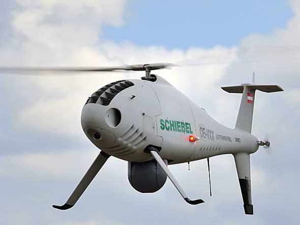 O Camcopter S-100, da austríaca Schiebel, é a única aeronave não tripulada aceita para voos de demonstração em Paris. Pode ser usado tanto em missões militares de reconhecimento como em filmagens aéreas civis
