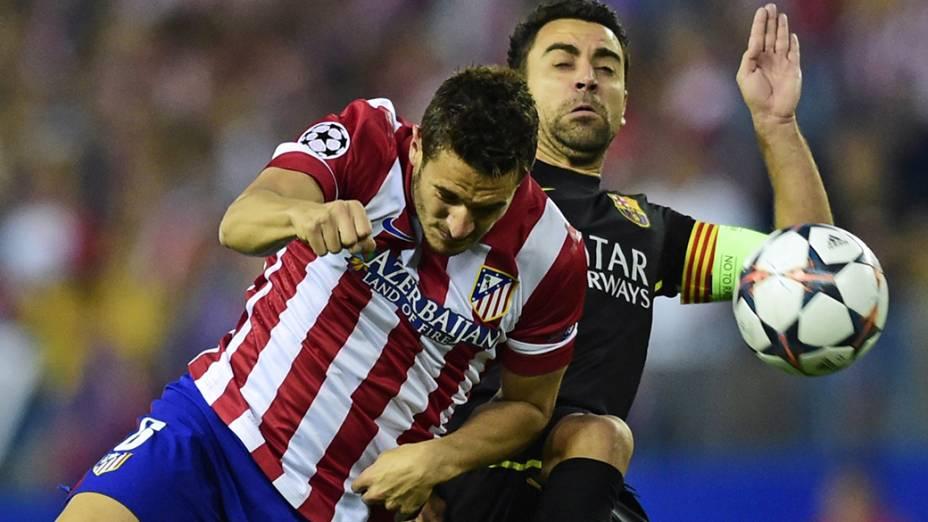 Lance da partida entre Atlético de Madri e Barcelona, no estádio Vicente Calderón