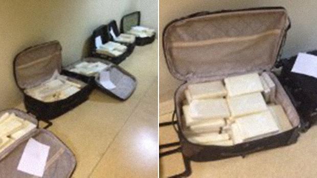 Malas com tabletes de cocaína apreendidas em contêiner de celulose