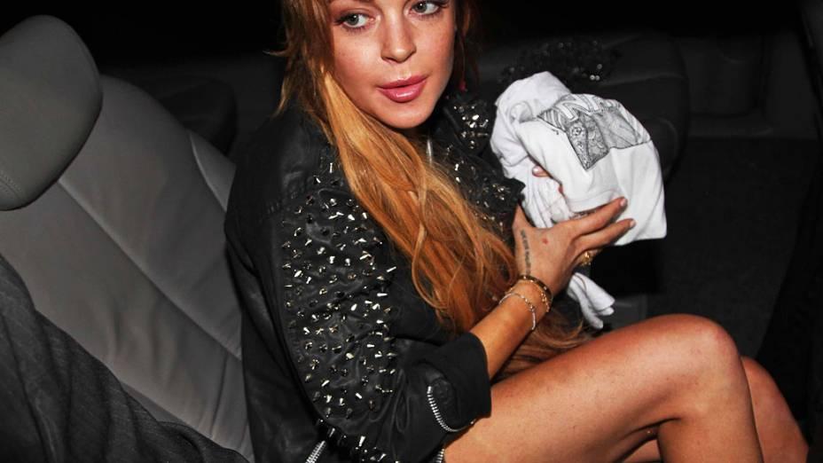 Lindsay Lohan chega em coquetel da John John em São Paulo