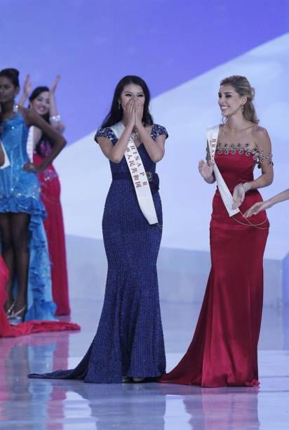 Chinesa comemora ao lado da brasileira Mariana Notarangelo, que ficou em 5º lugar