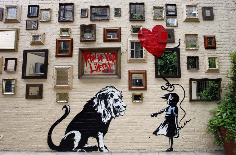 Mural de Banksy em um pub de Londres
