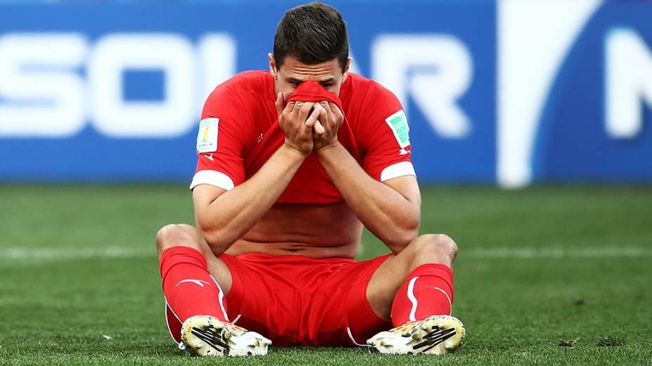 Jogador da Suíça lamentam derrota para a Argentina