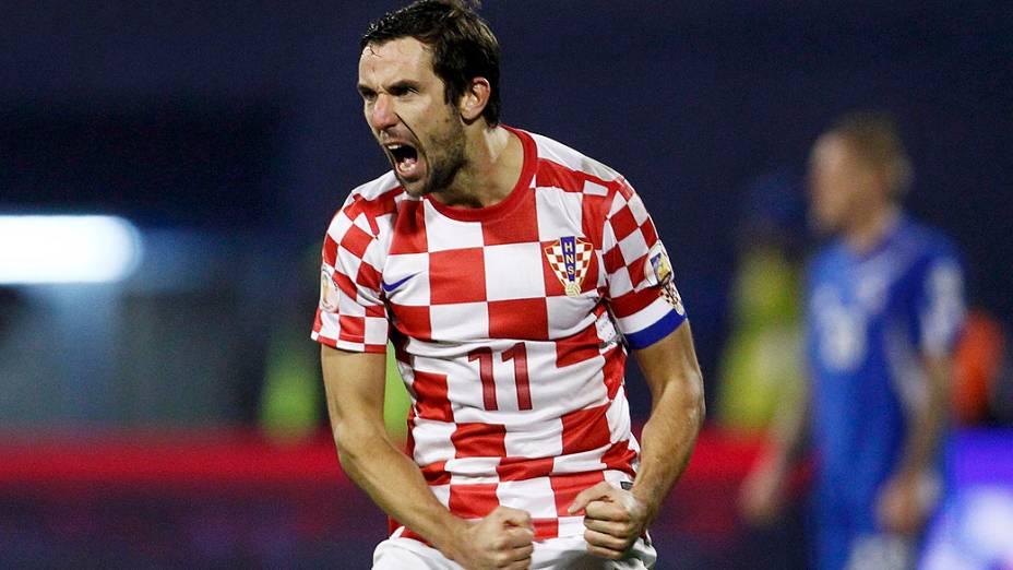 Darijo Srna comemora após marcar um gol na vitória de 2 a 0da Croácia sobre aIslândia, empartida válida pela repescagem europeia para Copa do Mundo 2014