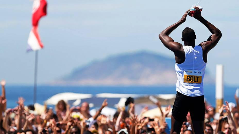 Usain Bolt durante desafio de 150 metros em Copacabana, Rio de Janeiro