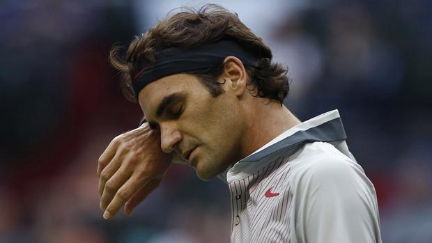 Federer após derrota para o francês Gael Monfils em Xangai: risco de não estar entre os oito melhores da temporada