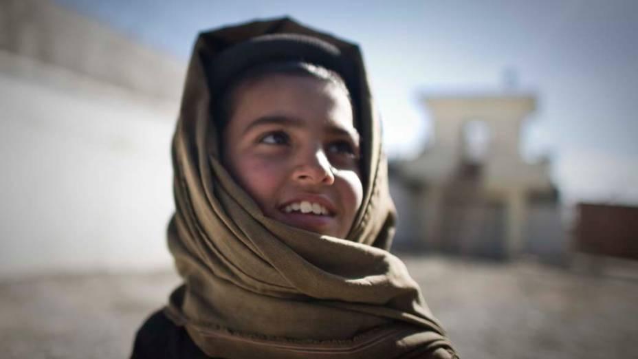 Garoto afegão na cidade de Musa Qala