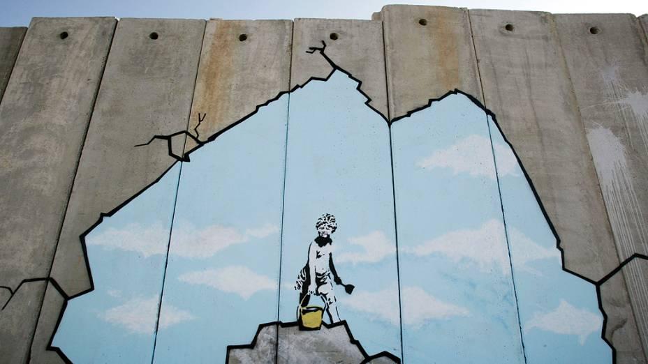 """Grafite intitulado """"Art Attack"""" do grafiteiro Banksy, no muro entre Israel e Csjordânia"""
