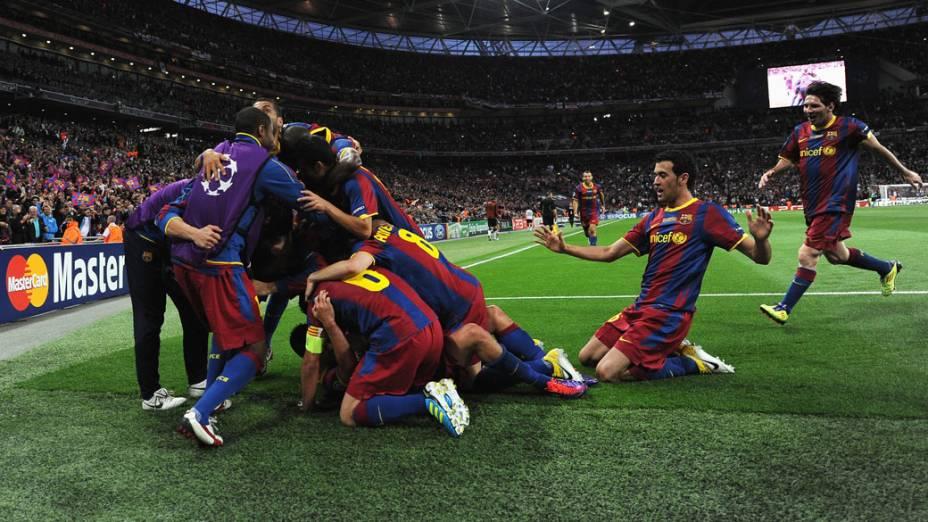 Jogadores do Barcelona comemoram o terceiro gol no jogo contra o Manchester United, pela final da UEFA Champions League, em Londres