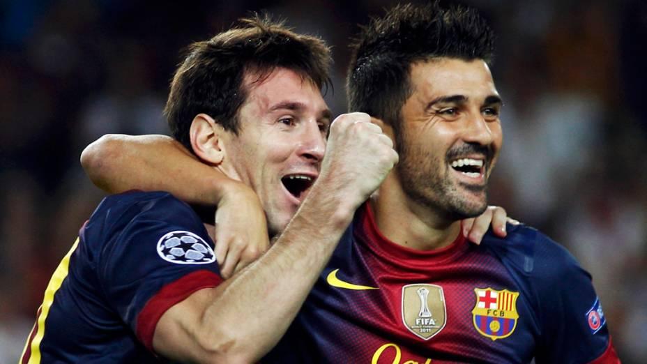 Lionel Messi e David Villa, do Barcelona, comemoram gol sobre o Spartak Moscou em partida válida pela primeira rodada da Liga dos Campeões da UEFA