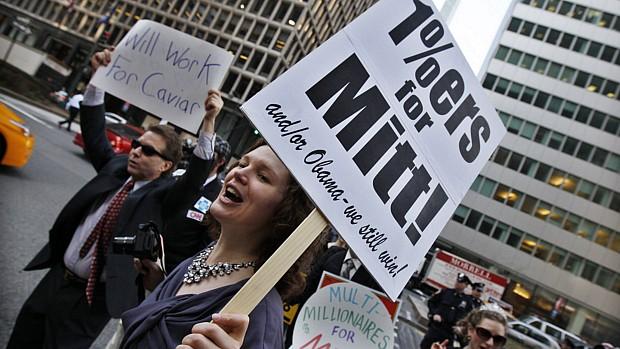 manifestantes-do-movimento-occupy-wall-street-em-protesto-contra-mitt-romney-nesta-quarta-feira-em-nova-york-original.jpeg
