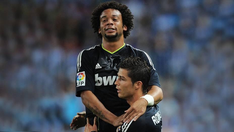 Cristiano Ronaldo e Marcelo comemoram gol em partida contra o Málaga válida pelo campeonato espanhol