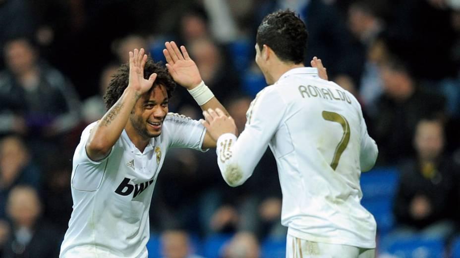 Cristiano Ronaldo e Marcelo comemoram gol em partida contra o Espanyol válida pelo campeonato espanhol