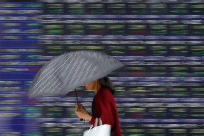 mulher-painel-bolsa-valores-toquio-japao-20110926-original.jpeg