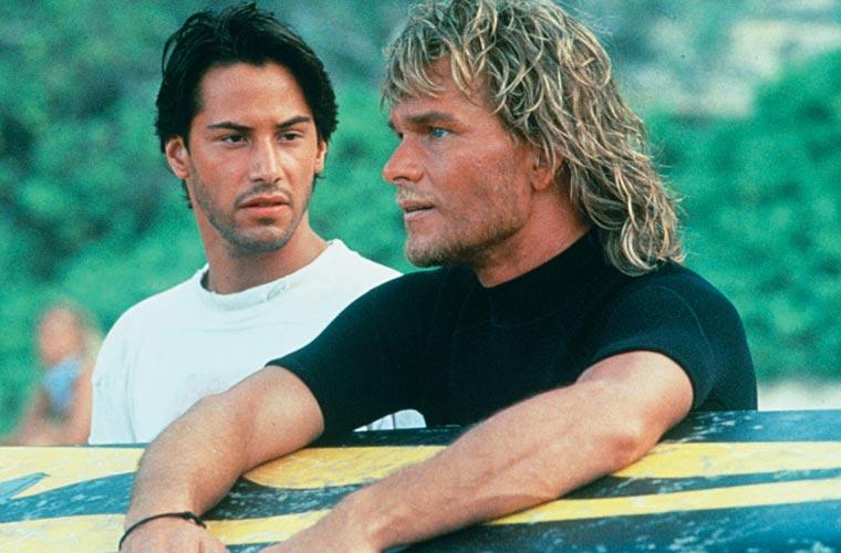 Com Keanu Reeves, em Caçadores de Emoção, de 1991