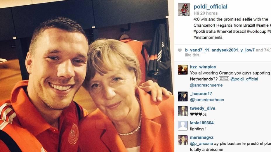 Lukas Podolski e Angela Merkel