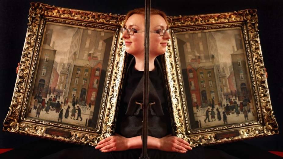 Quadro do artista inglês Laurence Stephen Lowry que será leiloado em Edimburgo, Escócia. O trabalho está avaliado em 300.000 libras, cerca de 810.000 reais
