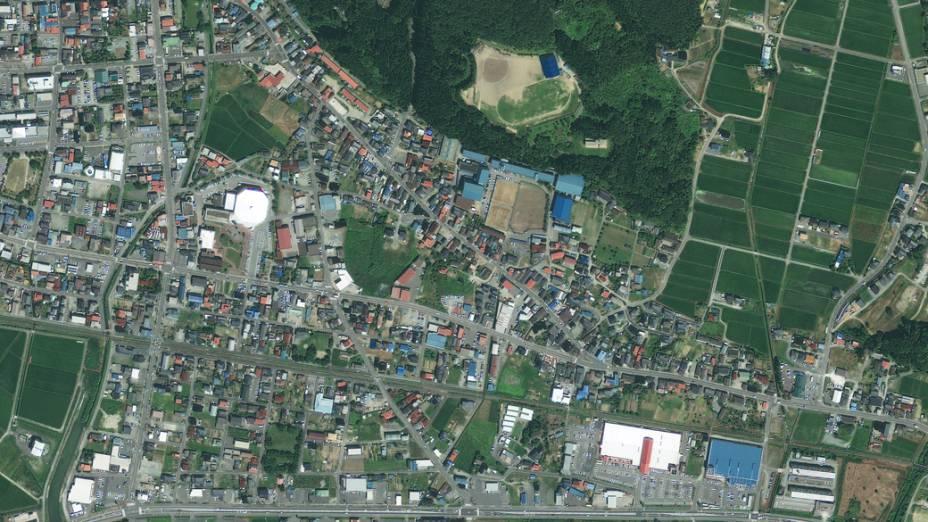 Imagem de satélite da cidade de Rikuzentakat antes do terremoto e tsunami que atingiram o Japão...