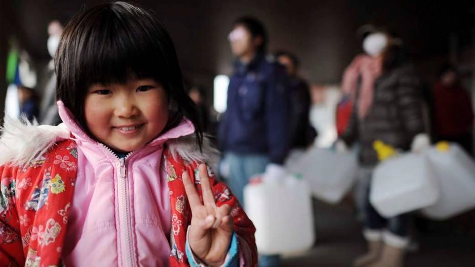 Criança em um abrigo em Tome, no Japão