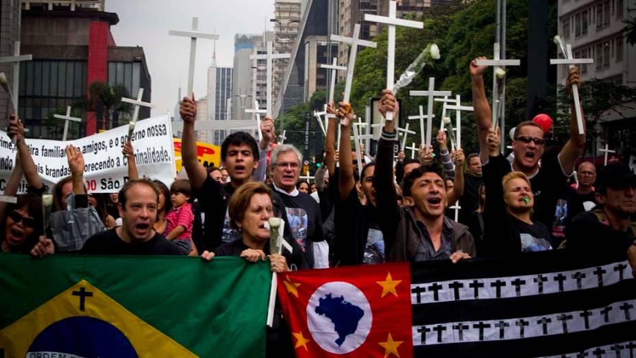 Comissão dos Direitos Humanos dos Policiais de São Paulo, profissionais de segurança pública e familiares de policiais militares mortos se reuniram em ato ecumênico no vão livre do MASP, em homenagem aos servidores mortos neste ano