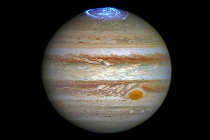 Auroras created by high-energy particles are seen on a pole of the planet Jupiter in a NASA composite image