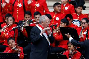 Peru's President Pedro Pablo Kuczynski plays the flute during the ministers swearing in ceremony at the Government Palace in Lima, Peru, July 28, 2016. REUTERS/Guadalupe Pardo