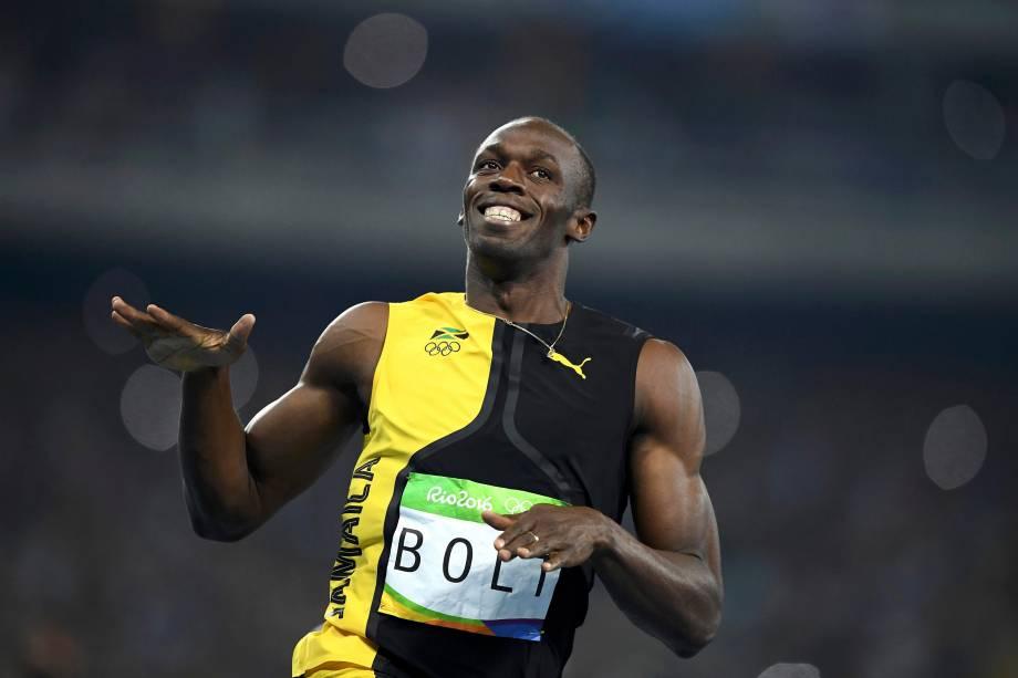 Tricampeão: Bolt sorri depois de cruzar a linha de chegada