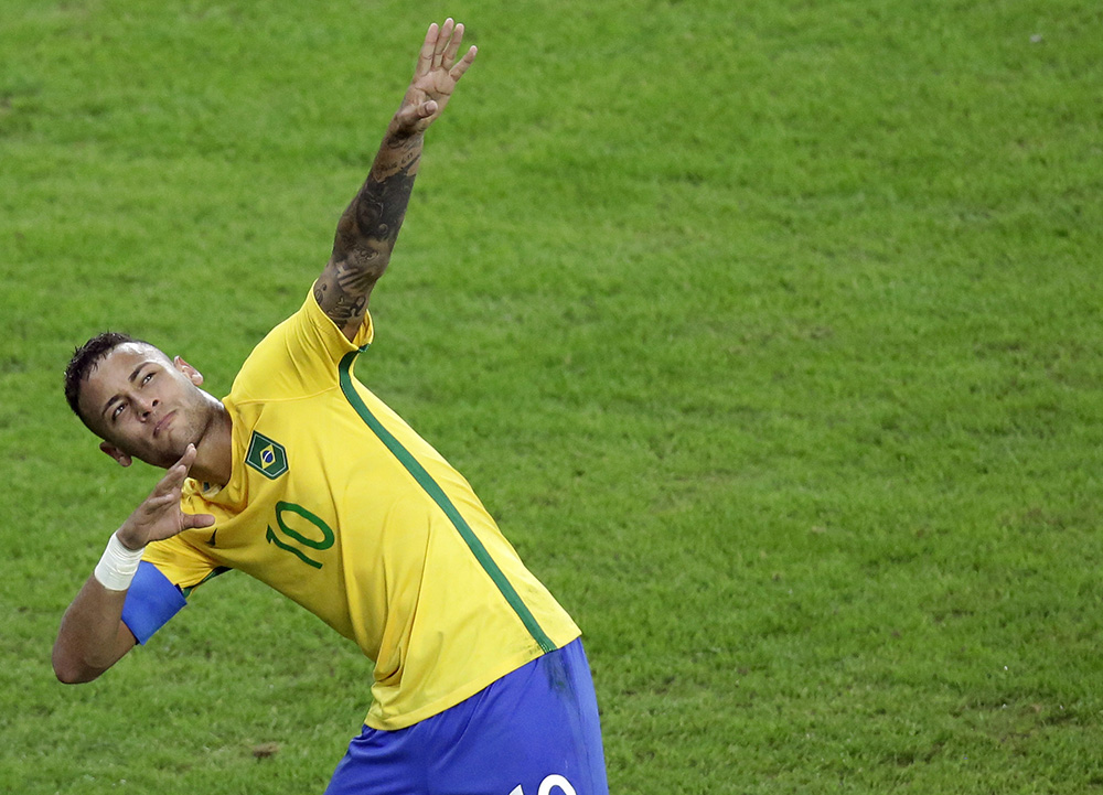 Brazil's Neymar celebrates after scoring his team's first goal on a free kick during the final match of the mens's Olympic football tournament between Brazil and Germany at the Maracana stadium in Rio de Janeiro, Brazil, Saturday Aug. 20, 2016. (AP Photo/Luca Bruno)