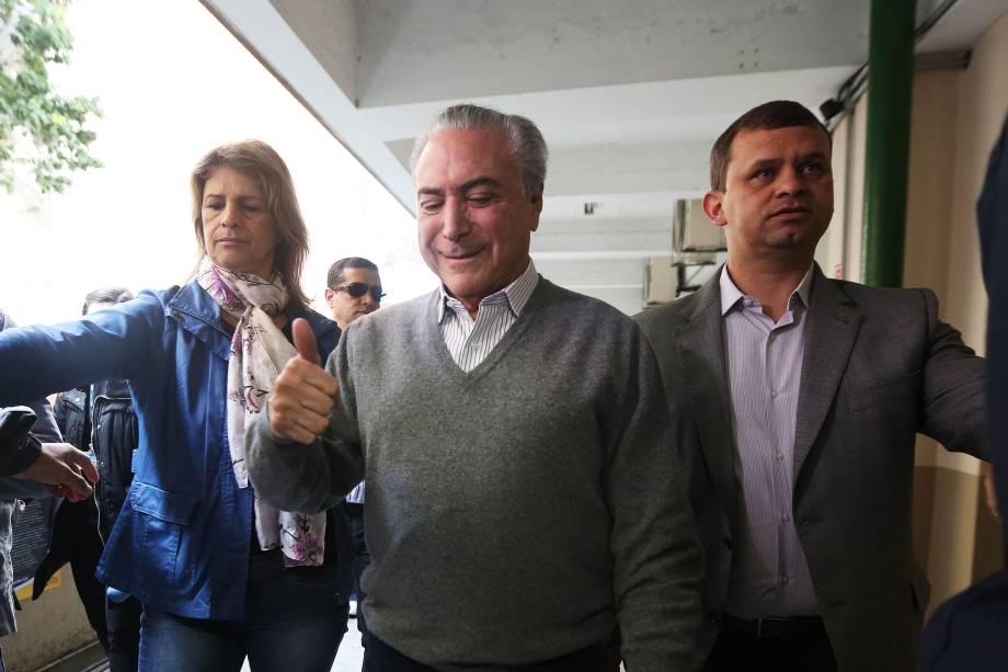 O presidente Michel Temer chega para votar na Pontifícia Universidade Católica (PUC), na zona oeste de São Paulo, na manhã deste domingo - 02/10/2016
