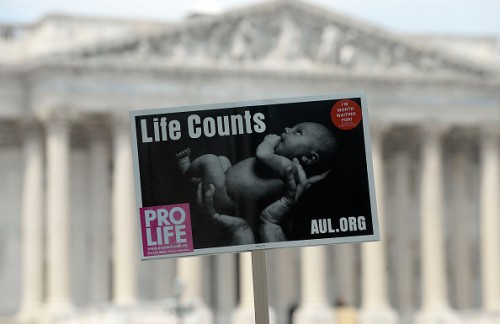 WASHINGTON, DC - JULY 28: Anti-abortion activist sign is held aloft during a rally opposing federal funding for Planned Parenthood in front of the U.S. Capitol on July 28, 2015 in Washington, DC. Sen. Rand Paul (R-KY)  announced a Senate deal to vote on legislation to defund Planned Parenthood before the Senate goes into recess in August. (Photo by Olivier Douliery/Getty Images)